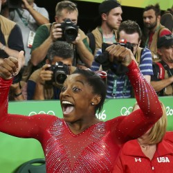 Simone Biles of USA celebrates winning the gold in the women's vault final.