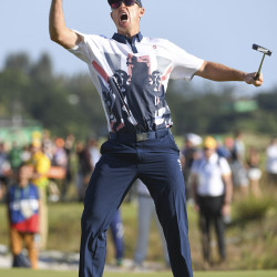 Justin Rose of Great Britian celebrates his birdie putt on the 18th hole Sunday to win the gold medal during the final round of Men's Golf at Olympic Golf Course in Rio De Janeiro.