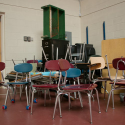 Desks and chairs can be seen in the gymnasium of Frankfort Elementary School in this June 2013 file photo. Frankfort Elementary officially closed its doors in 2013.