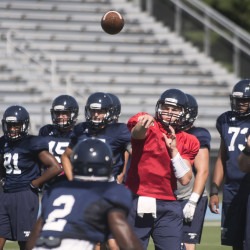 University of Maine quarterback Dan Collins throws a pass during practice Aug. 8 in Orono.