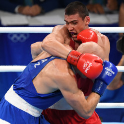 Vassiliy Levit (left) of Kazakhstan and Evgeny Tishchenko of Russia square off in the men''s heavyweight final boxing bout at Riocentro on Monday during the Rio 2016 Summer Olympic Games. Tishchenko won the gold medal.