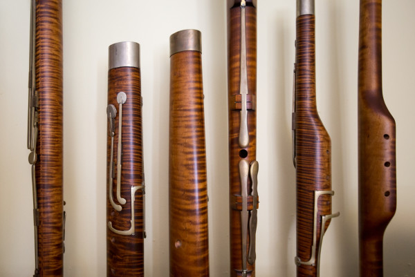Pieces of bassoons line the wall of Leslie Ross' bassoon fabrication studio on Aug. 11 at her home near the shore of Northern Bay in Penobscot.