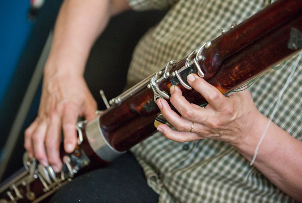 Leslie Ross plays a modern bassoon on Aug. 11 in her bassoon fabrication studio at her home near the shore of Northern Bay in Penobscot.