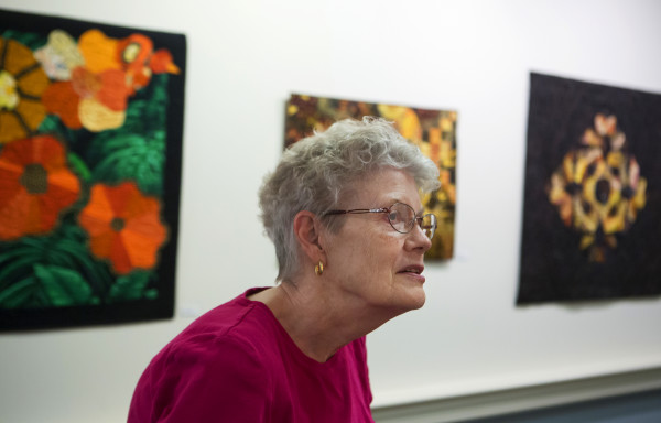 Hampden artist Sally Field, 75, shows off her quilts on Aug. 11 at the Boyd Place in Bangor. Field is one of several area quilters whose work is on exhibit at Boyd Place.