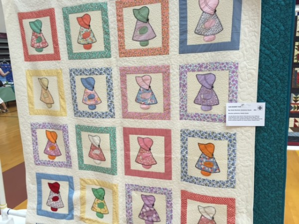 A traditional Sunbonnet Sue quilt can be seen on Aug. 12 at the Hancock County Quilters show and sale at Ellsworth High School in Ellsworth.