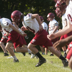 Bangor High School football players go through warmup drills in Bangor in this August 2015 file photo.