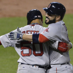 Sandy Leon (right) of Boston celebrates with Mookie Betts after his fifth-inning, two-run home run against the Baltimore Orioles on Wednesday at Oriole Park at Camden Yards. The Red Sox won 8-1.