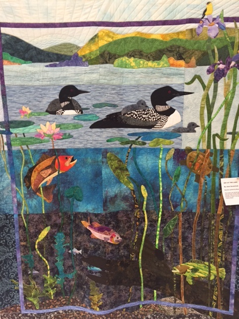 Quilter Jean Savalchak of Blue Hill's lake scene quilt can be seen on Aug. 12 at the Hancock County Quilters show and sale at Ellsworth High School in Ellsworth.