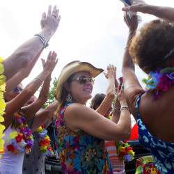 A group of women dance to music while tailgating before the Jimmy Buffet concert at the Bangor Waterfront Thursday.