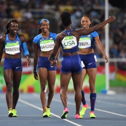 Tianna Bartoletta , Allyson Felix , English Gardner and Morolake Akinosun of the United States celebrate after running alone in a women's 4x100m relay heat in the Rio 2016 Summer Olympic Games at Rio De Janeiro. The Americans were impeded during the afternoon session, appealed, and were allowed to run again.