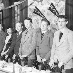 The 1947 Patten Academy boys basketball team was honored at a banquet hosted by the Bangor and Aroostook Railroad at the Penobscot Hotel in Bangor after beating Boston Latin 35-32 at the Boston Garden in the New England Basketball Tournament. From left are Carroll Hatt, manager Jack Seely, Thurston Townsend, captain Lloyd Wilson, coach Willis Phair, Donna Phair, Harley Dow, Howard Cunningham, Hollis Bates, Gilman Rossignol and Kenneth McCourt. Team member Lynn Vickery did not return with the team.