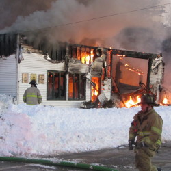 Firefighters from Owls Head and South Thomaston battle a blaze that destroyed a landmark Owls Head business, Frankie's Garage, in this February 2013 file photo.