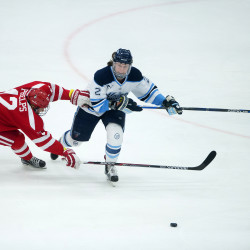 University of Maine's Dan Renouf (right) battles for a loose puck with Boston University's Chase Phelps during their hockey game at Alfond Arena in Orono in this January 2016 file photo.