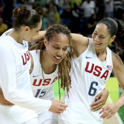 U.S. Olympic basketball players Diana Taurasi (from left), Brittney Griner and Sue Bird walk off the court after their gold medal victory over Spain on Saturday.
