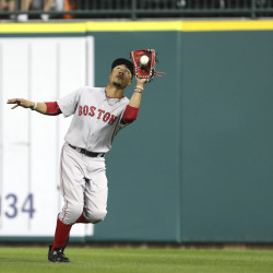 Boston Red Sox right fielder Mookie Betts (50) makes a catch during the sixth inning against the Detroit Tigers Saturday night at Comerica Park in Detroit.