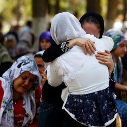 Women mourn as they wait in front of a hospital morgue in the Turkish city of Gaziantep, after a suspected bomber targeted a wedding celebration in the city, Turkey, Aug. 21, 2016.