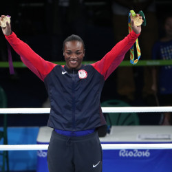 U.S. boxer Claressa Shields celebrates on the podium with her medals after the women's middleweight competition Sunday at the Rio Games at Riocentro Pavilion 6 in Rio de Janeiro, Brazil.