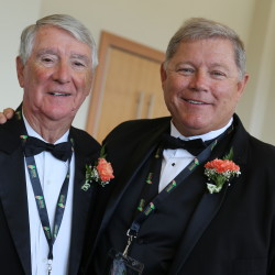 Maine Basketball Hall of Fame inductee Fern Masse (left) poses for a photo with Hall of Fame board of directors chairman Tony Hamlin, also a 2016 inductee, during Sunday's induction ceremony at the Cross Insurance Center in Bangor.