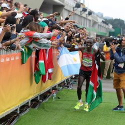 Eliud Kipchoge of Kenya celebrates after winning the men's marathon in the Rio Summer Olympic Games Sunday at the Sambodromo in Rio de Janeiro, Brazil.