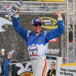 NASCAR Sprint Cup Series driver Kevin Harvick celebrates after winning the rain delayed Bass Pro Shops NRA Night Race Sunday at Bristol (Tenn.) Motor Speedway.