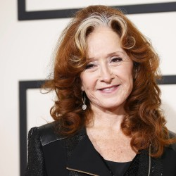 Singer Bonnie Raitt arrives at the 58th Grammy Awards in Los Angeles, Feb. 15, 2016.