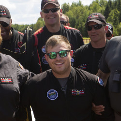 Travis Mills (center) with Ann and Gov. Paul LePage after the first lady and Mills successfully parachuted with the All Veteran Parachute team as part of the Freedom Fest in Fort Kent, Aug. 9, 2014.
