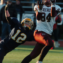 Foxcroft Academy's Jason Gould hauls in a pass as Boothbay Region's Jason Tilton defends in this November 2007 file photo of the Class C state final in Portland. Boothbay has opted to drop from varsity status to the club level for this season.