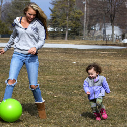 Arielle Oldmixon (left) plays with Aniyah Harvey, 2, at Mansfield Park in Bangor in March. The Bangor City Council voted Monday night to ban smoking in the city's parks to protect children and families from the effects of secondhand smoke.