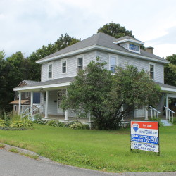 A for-sale sign is seen in Presque Isle, one of Aroostook County's relatively steady housing markets.