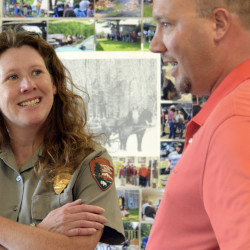 Christina Marts, a National Park Service community planner, talks with Richard Schmidt III, chairman of the Patten Board of Selectmen, on Friday at the Patten Lumbermen's Museum.
