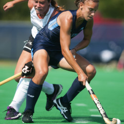University of Maine's Danielle Aviani (right) moves the ball around Providence's Madison Deeds during their season opener field hockey game on Friday in Orono.