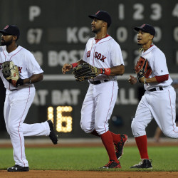 Boston Red Sox center fielder Jackie Bradley Jr. (left), left fielder Chris Young (center) and right fielder Mookie Betts run off the field after defeating the Kansas City Royals Saturday night at Fenway Park in Boston.