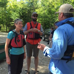 U.S. Secretary of the Interior Sally Jewell (left) and Elliotsville Plantation Inc. President Lucas St. Clair listen as Matthew Polstein chats with them before a canoe trip in Katahdin Woods and Waters National Monument on Saturday, Aug. 27, 2016.