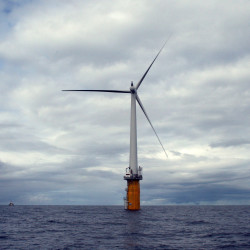 A floating wind turbine, installed by StatoilHydro and Siemens, is seen off the coast of Norway.