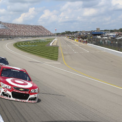 Sprint Cup Series driver Kyle Larson (front) races against driver Kasey Kahne during the Pure Michigan 400 Sunday at the Michigan International Speedway in Brooklyn, Michigan.