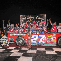 Wayne Helliwell Jr., left, and his team celebrate in Victory Lane after Helliwell won the 43rd HP Hood Oxford 250 Sunday night at Oxford Plains Speedway.