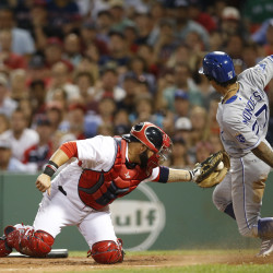 Kansas City's Raul Mondesi scores before Boston Red Sox catcher Sandy Leon can apply the tag during the sixth inning Sunday night at Fenway Park in Boston.
