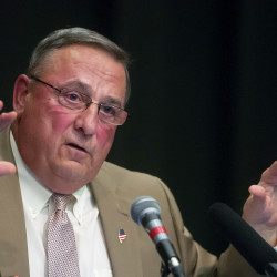 Gov. Paul LePage answers questions from the audience during a town hall meeting at  William S. Cohen School in Bangor on May 25.