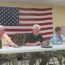 Owls Head selectmen (from left) Tom Von Malder, David Matthews and Linda Post listen during discussions at the annual town meeting Monday night.