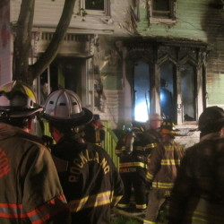 Rockland firefighters battle a blaze that damaged a house at 29 James St. in Rockland on Tuesday night.
