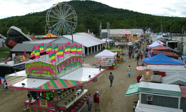 A handful of fairgoers wander down the midway on the opening day of the 2010 Blue Hill Fair. By suppertime, there was a steady stream of people heading into the fairgrounds.