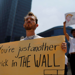 Demonstrators hold placards during a protest against the visit of U.S. Republican presidential candidate Donald Trump, at the Angel of Independence monument in Mexico City, Mexico, Aug. 31.