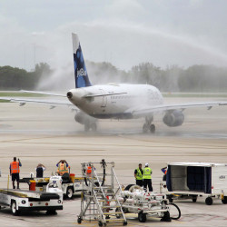 JetBlue Flight 387 taxis on to the runway under a water canon salute as it departs for Cuba on Wednesday out of Fort Lauderdale, Florida, to become the first U.S. airline to initiate commercial flights with Cuba in more than 50 years.