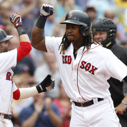 Boston Red Sox first baseman Hanley Ramirez (right) is congratulated by second baseman Dustin Pedroia (left) after hitting a grand slam against the Tampa Bay Rays during the fifth inning at Fenway Park.
