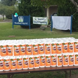 Rolls of paper towels stand on a folding table in front of where a new St. Croix Tissue sign later was ceremonially unveiled Wednesday at the Woodland Pulp building in Baileyville.