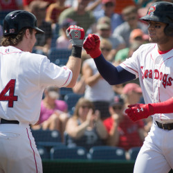 Cuban infielder Yoan Moncada (right) of the Portland Sea Dogs celebrates a home run with Ryan Hanigan in at Hadlock Field on Sunday. The Red Sox' top prospect is expected to be called up to the major league club in time for Friday's game at Oakland.