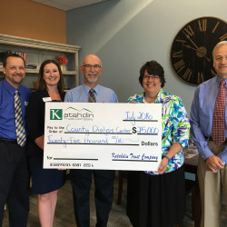 (L to R): Katahdin Trust employees Joe Clukey, Assistant Vice President & Retail Services Officer; Krista Putnam, Vice President of Marketing; and Peter St. John, Executive Vice President, Commercial Services; TAMC Interim President Glenda Dwyer and Jay Reynolds, MD. Chief Medical Officer.