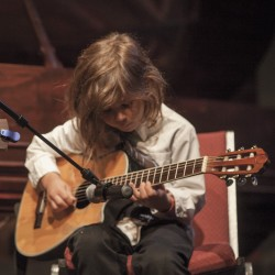 Eastport Elementary student Ellis Zipperer-Sánchez, six years old in this picture, performs during the 2015 Young Persons' Concert.