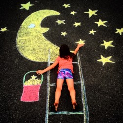 Kelley Dean of Levant creates huge chalk drawings with her daughter, Ava.