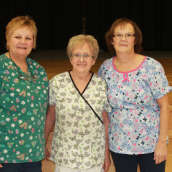 Pictured with two of her school nutrition program coworkers, at center is Lorette Albert. On her left is fellow employee Shelley Sirois and at right is Judy Bechard.